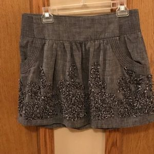 Grey skirt with embroidery